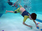 Austin Wancio (7) dives for Easter eggs during the Under the Sea Adventure at the Don Rodenbaugh Natatorium in Allen on Saturday, March 30, 2013. (Cooper Neill/The Dallas Morning News)