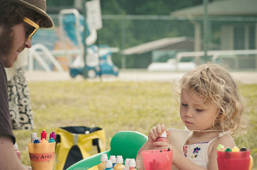 In the kids' creativity area of Appel Farm's 2012 Arts & Music Festival, these two spend some quality time watching and exploring.