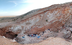 Jun 7, 2017 - Jebel Irhoud, Morocco - In a pair of papers published in Nature, an international team of researchers describe 22 human fossils from northwest Morocco that are approximately 300,000 years old. According to the authors, it is the earliest evidence of Homo sapiens ever discovered. View looking south of the Jebel Irhoud (Morocco) site. The remaining deposits and several people excavating them are visible in the center. At the time the site was occupied by early hominins, it would have been a cave, but the covering rock and much sediment were removed by work at the site in the 1960s. (Credit Image: � Shannon McPherron/MPI via ZUMA Wire)