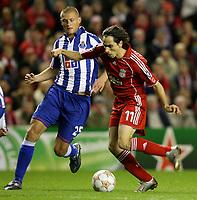 Photo: Paul Greenwood/Sportsbeat Images.<br />Liverpool v Porto. UEFA Champions League. 28/11/2007.<br />Porto's Przemystaw Kazmierczak, left, challenges Yossi Benayoun for the ball
