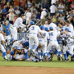 Jun 25, 2013; Omaha, NE, USA; UCLA Bruins celebrates after winning the NCAA Men's College World Series after game 2 of the College World Series finals against the Mississippi State Bulldogs at TD Ameritrade Park. UCLA defeated Mississippi State 8-0. Mandatory Credit: Derick E. Hingle-USA TODAY Sports