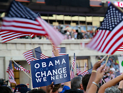 """""""Obama for the Change We Need"""" sign with American flags on the floor of the Democratic National Convention, Invesco Field at Mile High Stadium, Denver, Colorado, August 28, 2008."""