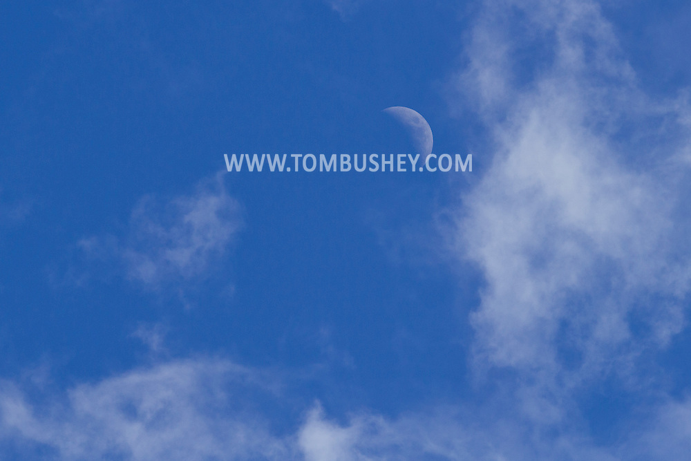 Citrus Heights, California - The cresent moon and clouds in the daytime sky on March 6, 2014.