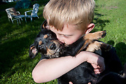 Portrait session with neighbors D'andre and Victoria Conant and their mixed breed dog Mario