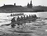The University of Washington women's junior-varsity crew, foreground, stroke through Lake Union in a recent early morning workout. (Josef Scaylea / The Seattle Times, 1982)