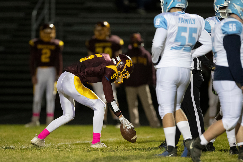 Brandywine's Brock Dye places the ball at the line of scrimmage as required by the MHSAA during the Comstock-Brandywine high school football game on Friday, October 30, 2020, at Selge Field in Niles, Michigan.
