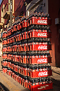 Coca-cola bottles stacked up for delivery in Oaxaca, Mexico.