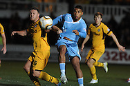 Reuben Reid of Plymouth Argyle looks to go past Newport's Darcy Blake (l). Skybet football league two match, Newport county  v Plymouth Argyle at Rodney Parade in Newport, South Wales on Tuesday 8th April 2014.<br /> pic by Andrew Orchard, Andrew Orchard sports photography.