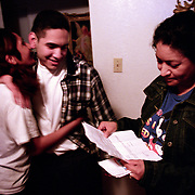 11/15/02<br />Fourteen hours afer walking out of prison Angel's mother, Trinidad, right, looks over his official release paper as Angel's sister, Debbie, embraces her brother.