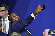 U.S. Senator Tim Scot takes a selfie during the Keep America Great Rally at the in the North Charleston Coliseum February 28 2020 in North Charleston, South Carolina.
