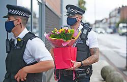©Licensed to London News Pictures 29/09/2020  <br /> Croydon, UK. Police officers from around London continue to drop off flowers for Sgt Matt Ratana at Croydon Custody Centre. The murder investigation continues after the death of police sergeant Matt Ratana at the Croydon Custody Centre in South London last week. Photo credit:Grant Falvey/LNP