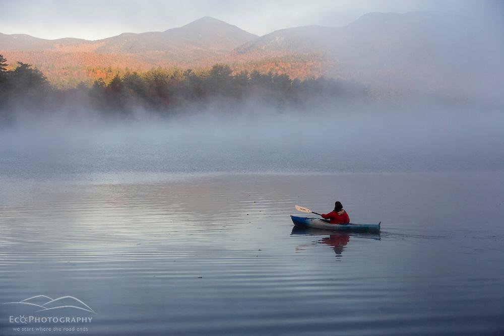 Kayaking in the fog on Chocorua Lake in New Hampshire USA (MR)