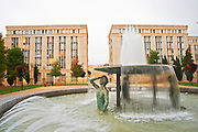 Ricardo Bofill architecture at Antigone. Strange statue of half a man, torso, standing in a spray of water. Montpellier. Languedoc. Mock roman style apartment block. France. Europe.