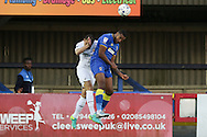 Swansea City defender Franck Tabanou (14) and AFC Wimbledon striker Tyrone Barnett (23) during the EFL Trophy match between AFC Wimbledon and U23 Swansea City at the Cherry Red Records Stadium, Kingston, England on 30 August 2016. Photo by Stuart Butcher.