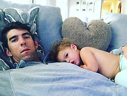 "Michael Phelps releases a photo on Instagram with the following caption: ""Little man and I just being lazy today\ud83d\ude48"". Photo Credit: Instagram *** No USA Distribution *** For Editorial Use Only *** Not to be Published in Books or Photo Books ***  Please note: Fees charged by the agency are for the agency's services only, and do not, nor are they intended to, convey to the user any ownership of Copyright or License in the material. The agency does not claim any ownership including but not limited to Copyright or License in the attached material. By publishing this material you expressly agree to indemnify and to hold the agency and its directors, shareholders and employees harmless from any loss, claims, damages, demands, expenses (including legal fees), or any causes of action or allegation against the agency arising out of or connected in any way with publication of the material."