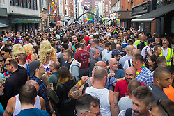 "Portland Place, London, June 25th 2016. Thousands of LGBT people and their supporters gather for Pride in London, a colourful celebration of the hard-won rights of lesbian, gay, bisexual and transgender  people. PICTURED: Old Compton Street in Soho is rammed with revellers enjoying the atmosphere of London's ""gay"" street."