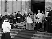 05/10/1952<br /> 10/05/1952<br /> 05 October 1952<br /> Franciscan Church, Merchant's Quay, Novena Mass.<br /> His Excellency Gerald O'Hara, Papal Nuncio, blesses the crowd outside the church. The Nuncio was at the Friary on Merchants Quay, Dublin to preside over one of the Novena Masses.