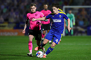 AFC Wimbledon midfielder Alex Woodyard (4) dribbling during the EFL Sky Bet League 1 match between AFC Wimbledon and Peterborough United at Plough Lane, London, United Kingdom on 2 December 2020.