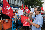 Peter Kavanagh, Unite London & Eastern Regional Secretary, addresses Unite the union members protesting outside the Euston construction site for the HS2 high-speed rail link regarding trade union access to construction workers building tunnel sections for the project on 6th August 2021 in London, United Kingdom. Unite claims that HS2s joint venture contractor SCS, formed by Skanska, Costain and Strabag, has been hindering meaningful trade union access to HS2 construction workers in contravention of the HS2 agreement.