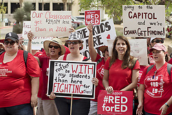April 26, 2018 - Phoenix, Arizona, U.S - In the largest teacher strike in Arizona history, teachers walked out on Thursday April 26, and demonstrated at the capitol in Phoenix, to demand improvements to state funding of schools. At least 50,000 teachers and supporters from all over the state converged to apply pressure to the governor and legislature. The state ranks 49th in per-pupil spending in the nation. Teachers decided to strike after the governor proposed a deal that increased teacher salaraies 20% over two years, but did no offer anything for support staff or general school funding to cover everything from  textbooks to facilities. Red for Ed reminds supporters to wear the color to express their support of teachers. (Credit Image: © Rick D'Elia via ZUMA Wire)