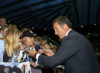 Photo. Glyn Thomas. <br /> Newcastle United v Hapoel Bnei Sakhnin. <br /> UEFA Cup, 1st round, 1st leg. 16/09/2004.<br /> Newcastle manager Graeme Souness (R) signs autographs for fans before his first game in charge<br /> NORWAY ONLY