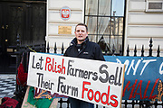 Polish protest against government plans to ban small food producers, outside the Polish embassy in London, UK. The Poland government plans to stop small producers from selling their produce, allowing only large scale producers onto the market. This is equivalent that if in the UK, there were a ban on people making and selling all sorts of food stuffs, like pies, jam, cheese etc.