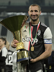 TURIN, May 20, 2019  FC Juventus' Giorgio Chiellini poses with the trophy during the trophy ceremony at the end of the Serie A soccer match between FC Juventus and Atalanta in Turin, Italy, May 19, 2019. FC Juventus sealed the title with a 2-1 victory over FC Fiorentina on April 20, 2019. (Credit Image: © Alberto Lingria/Xinhua via ZUMA Wire)