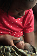 Patience Karkuah, 21, breast feeds her baby girl, who was born just a few hours ago, at the Redemption hospital in Monrovia, Montserrado country, Liberia  on Wednesday April 4, 2012.