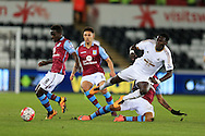 Bafetimbi Gomis of Swansea city is tackled as Idrissa Gana Gueye of Aston Villa (l) gets the ball away.. Barclays Premier league match, Swansea city v Aston Villa at the Liberty Stadium in Swansea, South Wales on Saturday 19th March 2016.<br /> pic by  Andrew Orchard, Andrew Orchard sports photography.