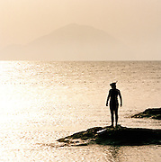 A diver at Pollara beach, Salina, Aeolian Islands, Italy