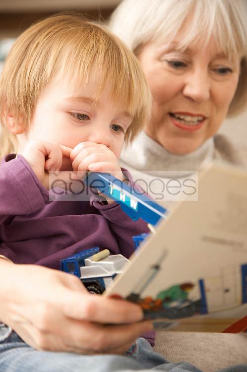 Grandmother and grandchild with coloring book