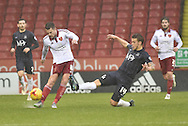 Sheffield United midfielder Paul Coutts kicks forward attempted block by Southend United midfielder Kevan Hurst during the Sky Bet League 1 match between Sheffield Utd and Southend United at Bramall Lane, Sheffield, England on 14 November 2015. Photo by Ian Lyall.