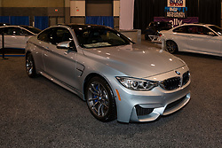 CHARLOTTE, NORTH CAROLINA - NOVEMBER 20, 2014: BMW M4 on display during the 2014 Charlotte International Auto Show at the Charlotte Convention Center.