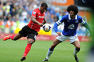 Cardiff city 's Fraizer Campbell (l) battles for the ball with Everton's Marouane Fellaini . Barclays Premier league, Cardiff city v Everton at the Cardiff city Stadium in Cardiff,  South Wales on Saturday 31st August 2013. pic by Andrew Orchard,  Andrew Orchard sports photography,