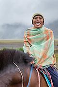 Portrait of man riding horse, Mt Bromo, Tengger massif, East Java, Indonesia, Southeast Asia