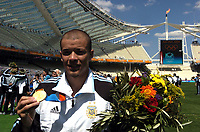 28/08/04 - ATHENS - GREECE -  - OLYMPIC FOOTBALL - FINAL MATCH - MENS  -  <br />ARGENTINA (1) Vs. PARAGUAY (0) At the Olympic Stadium in Athens. Argentine win the goal medal<br />Argentine player ANDRES D'ALESSANDRO with his gold medal.<br />© Gabriel Piko / Argenpress.com / Piko-Press