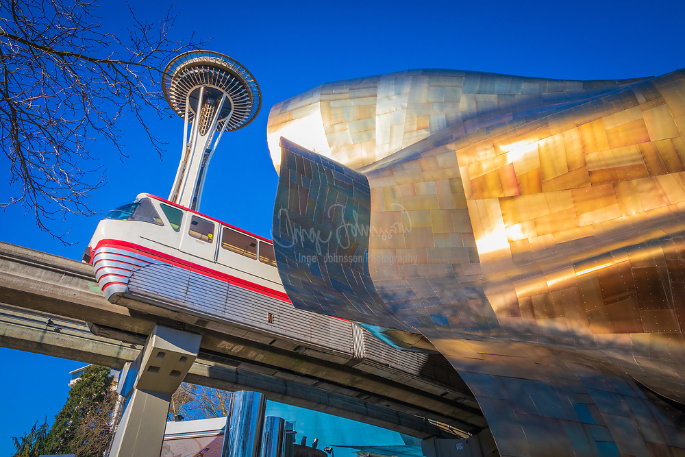 Space Needle and the Experience Music Project (EMP) building at Seattle Center. Seattle Center is a park and arts and entertainment center in Seattle, Washington.