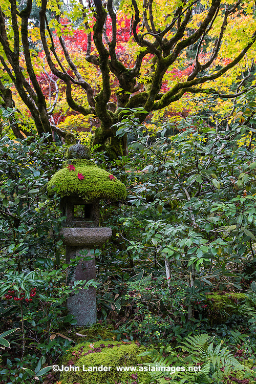 Ishidoro at Koto-in - Ishidoro lanterns are usually used to decorate Japanese gardens, shrines and temples rather than for providing light, although occasionally they are lit up with candles inside during festivals.  Ishidoro Lanterns were introduced to Japan via China in the 6th century. The earliest lanterns, found only in temple grounds, were designed to hold the flame representing Buddha. Light helps us overcome the darkness of ignorance. Ishidoro were originally used at temples, gardens and shrines. Around the 16th century stone lanterns were adopted and placed in the gardens of teahouses.