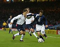 Photo: Andrew Unwin.<br />Scotland v USA. International Challenge. 12/11/2005.<br />Scotland's Neil McCann (R) tussles with the USA's Steve Cherundolo (L).