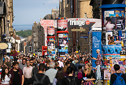 Edinburgh, Scotland, UK. 2 August 2019. On the opening day of the Edinburgh Festival Fringe the Royal Mile in Edinburgh's Old Town was thronged with people eager to enjoy the street entertainers and sunny warm weather. Iain Masterton/Alamy Live News