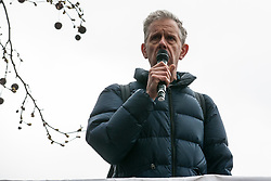 London, UK. 16th March, 2019. Chris Nineham of Stop The War Coalition addresses thousands of people on the March Against Racism demonstration on UN Anti-Racism Day against a background of increasing far-right activism around the world and a terror attack yesterday on two mosques in New Zealand by a far-right extremist which left 49 people dead and another 48 injured.