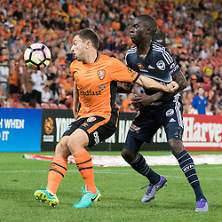 BRISBANE, AUSTRALIA - OCTOBER 7: Tommy Oar of the Roar and Jason Geria of the Victory compete for the ball during the round 1 Hyundai A-League match between the Brisbane Roar and Melbourne Victory at Suncorp Stadium on October 7, 2016 in Brisbane, Australia. (Photo by Patrick Kearney/Brisbane Roar)