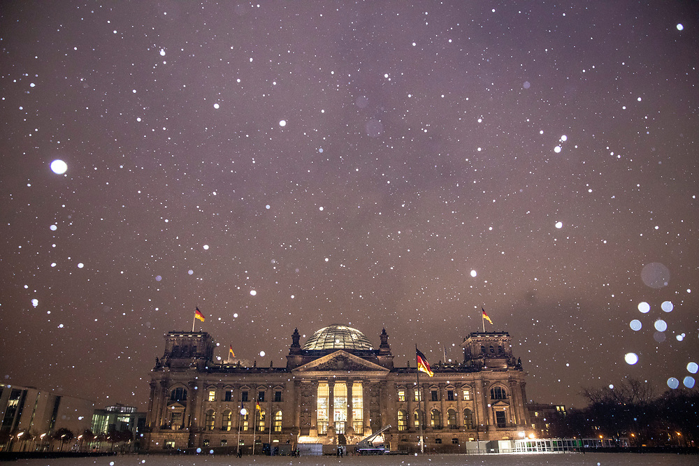 A view of the Reichstag building (seat of the Bundestag Parliament) during snowfall at the central Mitte district in Berlin, Germany, February 09, 2021. Germany is experiencing several days of sub-zero temperatures strong winds and snow.
