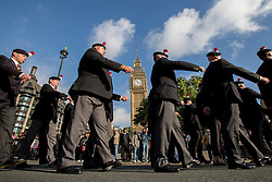 © licensed to London News Pictures. London, UK 15/10/2013. 400 veterans from 2nd Battalion the Royal Regiment of Fusiliers marching through Whitehall in London to protest against the Battalion being disbanded as part of the Army 2020 defence review. Photo credit: Tolga Akmen/LNP