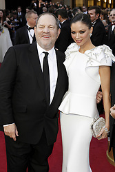 Oct. 10, 2017 -  (File Photo) - Movie producer Harvey Weinstein is being accused of sexual harassment allegations, which has led to him being fired. PICTURED: Feb. 26, 2012 - Hollywood, California, U.S. - HARVEY WEINSTEIN and wife GEORGINA CHAPMAN attending the 84th Academy Awards  during the Oscars.. (Credit Image: © Future-Image/ZUMAPRESS.com)