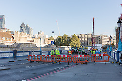 © Licensed to London News Pictures. 01/10/2016. LONDON, UK.  Construction work begins on Tower Bridge. Tower Bridge closes to traffic today for three months for major renovations and repair. Pedestrians are still able to walk across the bridge. Photo credit: Vickie Flores/LNP