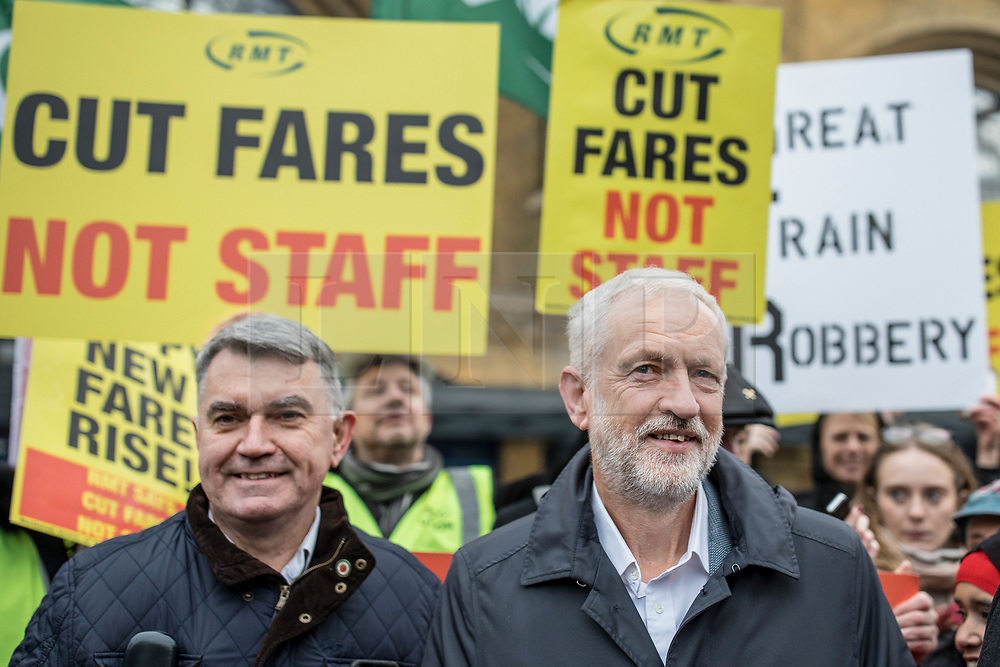 © Licensed to London News Pictures. 02/01/2019. London, UK. Labour Party Leader Jeremy Corbyn (R) and General Secretary of the RMT Mick Cash (L) join protesters at King's Cross as passengers begin a 'national day of action' over 3. 1% fare increases. Photo credit: Rob Pinney/LNP