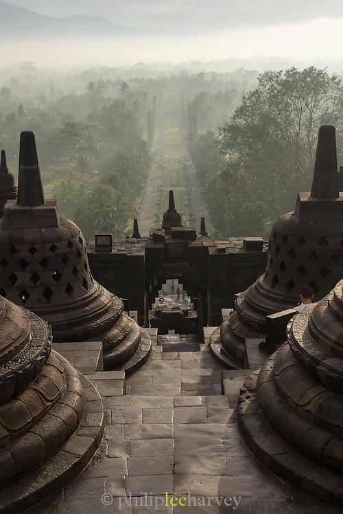 View between the Stupas to the entrance of Borobudur, Borobudur, Kedu Valley, South Central Java, Java, Indonesia, Southeast Asia