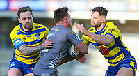 Catalans Dragons' Tom Davies is tackled by Warrington Wolves' Blake Austin and Toby King<br /> <br /> Photographer Alex Dodd/CameraSport<br /> <br /> Rugby League - Betfred Challenge Cup Quarter Finals - Catalans Dragons v Warrington Wolves - Friday 7th May 2021 - Emerald Headingley Stadium - Leeds<br /> <br /> World Copyright © 2021 CameraSport. All rights reserved. 43 Linden Ave. Countesthorpe. Leicester. England. LE8 5PG - Tel: +44 (0 116 277 4147 - admin@camerasport.com - www.camerasport.com
