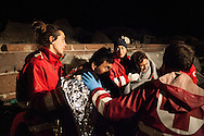 The Hellenic Red Cross treat an Afghan man after the boat he was using to enter Greece from Turkey had engine trouble, and he spend three hours at sea in cold temperatures. Molyvos harbour, Lesvos island, Greece.